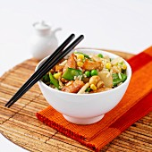 Chicken stir-fry with peas, mushrooms and rice (Asia)