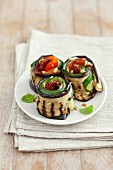 Grilled aubergine and courgette rolls filled with dried tomatoes and cream cheese