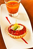 A strawberry and rhubarb tartlet with whipped cream