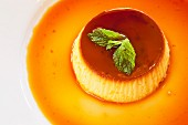 Creme caramel garnished with mint leaves