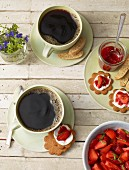 Coffee with strawberry biscuits
