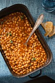 Baked beans in a baking tin