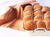 Buchteln (baked, sweet yeast dumplings) in a baking tin