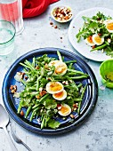 Bean salad with hard-boiled egg, coriander and almonds