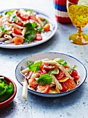 Pasta salad with tomatoes and basil