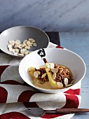 Amaretto pears with chocolate crumble and almonds in sabayon