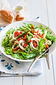 A mixed leaf salad with fennel, rocket, green beans and chilli
