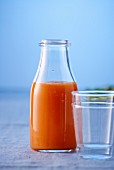 A bottle of orange and carrot juice