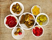 Pickled peppers in white bowls