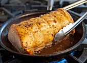 Pork roulade being fried