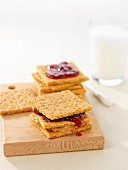 Crackers with peanut butter and jam