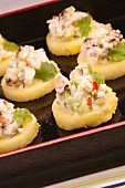 Crab salad on pineapple slices