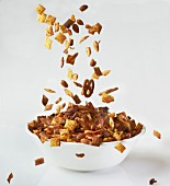Snacks falling into a bowl