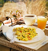 Breakfast with scrambled eggs, coffee and orange juice for Mother's Day