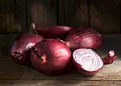 Red onions on a wooden surface