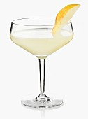 A cocktail garnished with a slice of Williams pear