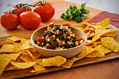 Corn salsa with black beans and tortilla crisps