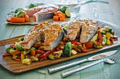 Roasted salmon on a bed of mixed vegetables