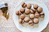 Chocolate macaroons with sesame seeds