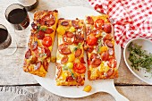 Peperoni sausage and tomato pizza
