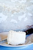 Homemade ricotta on a plate with a knife