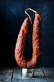 A whole smoked salami from Sardinia