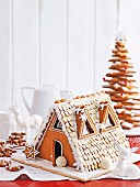 A gingerbread house and gingerbread stars for Christmas