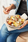 Roast potato salad with blue cheese, onions and pancetta
