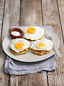 White cabbage and potato fritters topped with fried eggs