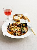 Seafood and fennel stew with grilled bread