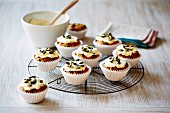 Carrot cupcakes with cream cheese and pumpkin seeds