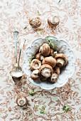 Brown mushrooms in a ceramic dish