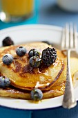Buttermilk pancakes with berries and maple syrup