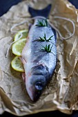 Fresh sea bass with lemons and rosemary