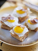 Fried eggs and truffles on toast