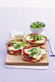 Marinated bocconcini pizzas with tomatoes and rocket