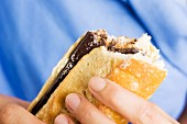 Hands holding a chocolate spread sandwich