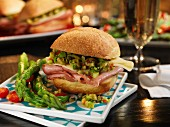 Mufuletta sandwich with green asparagus