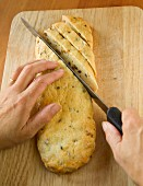 Cantucci being sliced