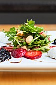 Rocket and strawberry salad with almonds, sherry vinaigrette, goat's cheese and onion chutney