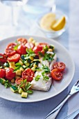 Pollack fillet with tomatoes and courgettes
