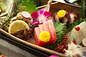 Sashimi with fruit and flowers