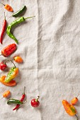A selection of summer chilli peppers on a linen cloth