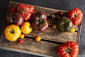 A selection of heirloom tomatoes on a wooden board
