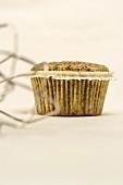 A poppyseed muffin in a paper case