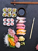 A platter of sushi featuring sashimi, ginger and wasabi