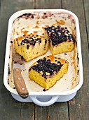 Yeast cake with blueberries in a baking dish