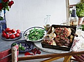 Roast lamb with pomegranate seeds and vegetables for Easter