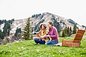 Romantic couple enjoying champagne picnic, Wallberg, Tegernsee, Bavaria, Germany
