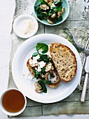 Crostini topped with mushrooms and spinach